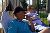 Day 13: Wayne and Joy sitting on the stoop at the WigWam Motel.
