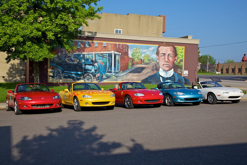 """Day 4: Photographer and civic pride enthusiast Jane Reed asked us to pose our Miatas in front of this mural in Cuba, MO .  A version of this photo is currently part of the slideshow at the top of Cuba Chamber of Commerce Website.  <a href=""""http://cubamochamber.com/"""" target=""""_blank"""">Click Here for Cuba Chamber of Commerce Website </a>"""