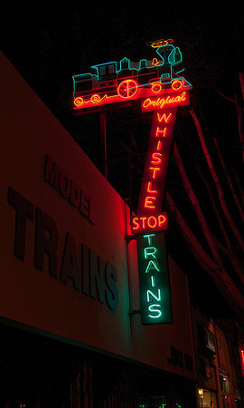 Day 14: The terrific neon of the Whistle Stop Trains sign (photo from the web).