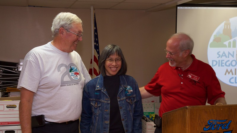 Co-Founder Cindy Paloma receives here recognition T-shirt.