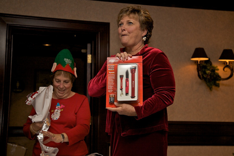Laurie Waid is excited beyond belief when she unwraps a RED Snap-on flashlight kit to match her RED outfit!