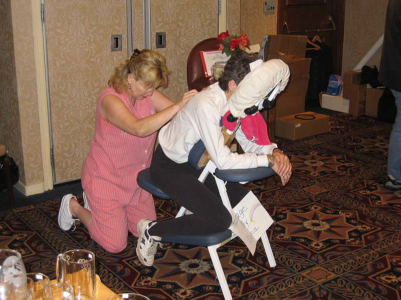 """Teri Cardell receives a nice massage from Dona Thompson.  Hmm... I wonder if Teri's need for a massage had anything to do with  <a href=""""http://thephotobooth.smugmug.com/gallery/253051/3/9987855"""">THIS?</a> :)"""