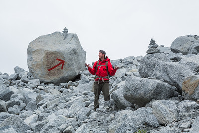 Man in red jacket lost on obvious trail
