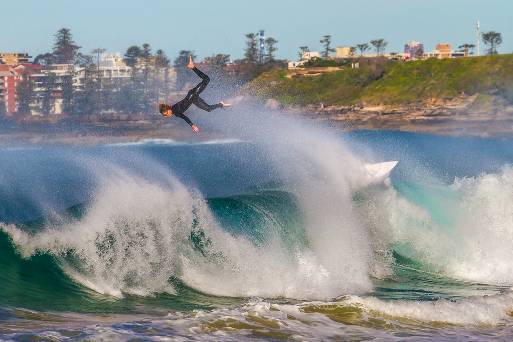 After a windy night I headed south down to Curl Curl beach hoping for some decent waves. I wasn't disappointed but was nearly washed off the rocks. <br /> Surfing today was not for the faint-hearted.