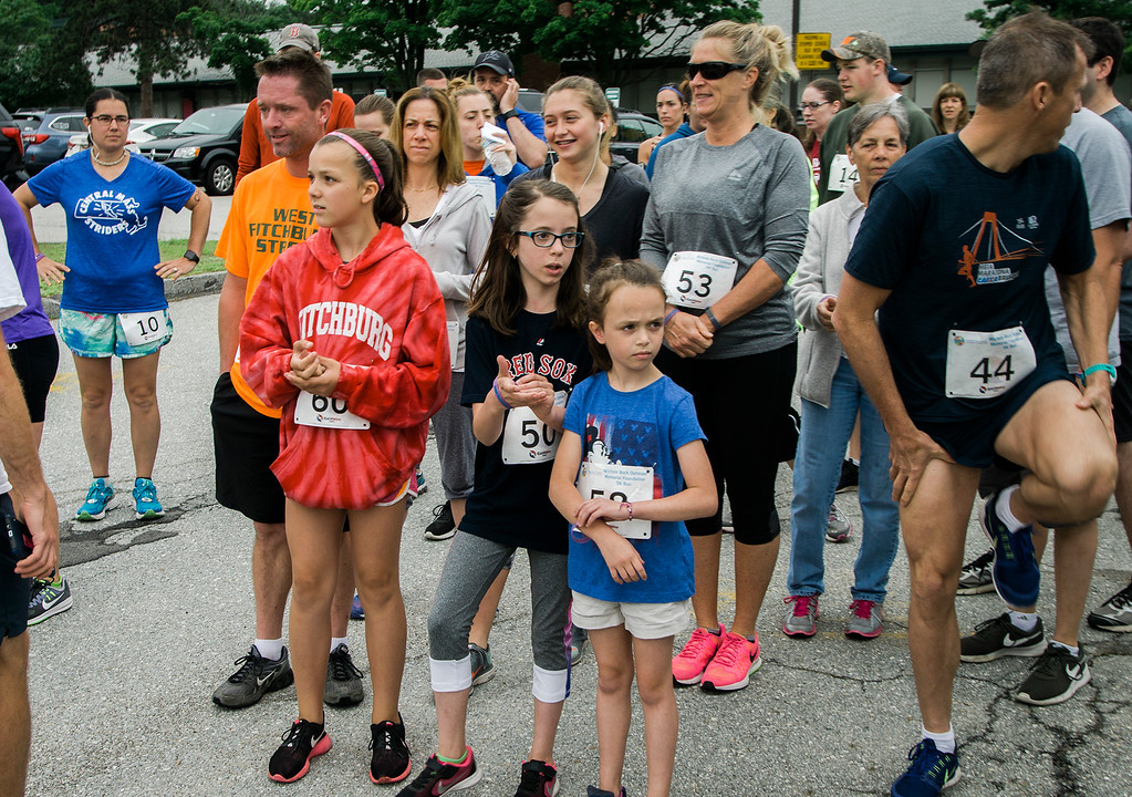 . Runners gather ahead of the Michele Bock Oshman Memorial Foundation 5K held at Northwest Elementary School in Leominster on Saturday, June 17, 2017. Oshman died unexpectedly in April 2016 after suffering a stroke at the age of 32. She had been working in Leominster for roughly a decade at the time of her death. SENTINEL & ENTERPRISE / Ashley Green