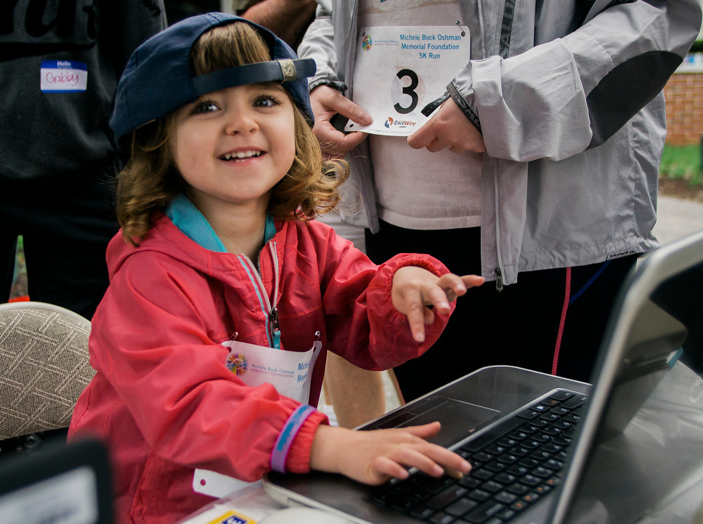 . Jenna Oshman, 3, the daughter of Michele Oshman, pretends to check in runners ahead of the Michele Bock Oshman Memorial Foundation 5K held at Northwest Elementary School in Leominster on Saturday, June 17, 2017. Oshman died unexpectedly in April 2016 after suffering a stroke at the age of 32. She had been working in Leominster for roughly a decade at the time of her death. SENTINEL & ENTERPRISE / Ashley Green