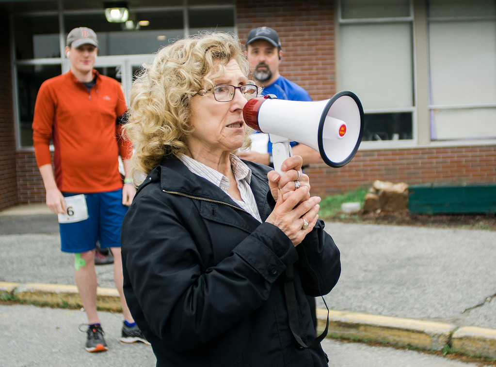 . Mickey Bock, the mother of Michele Oshman, speaks to the runners ahead of the Michele Bock Oshman Memorial Foundation 5K, held at Northwest Elementary School in Leominster on Saturday, June 17, 2017. Oshman died unexpectedly in April 2016 after suffering a stroke at the age of 32. She had been working in Leominster for roughly a decade at the time of her death. SENTINEL & ENTERPRISE / Ashley Green