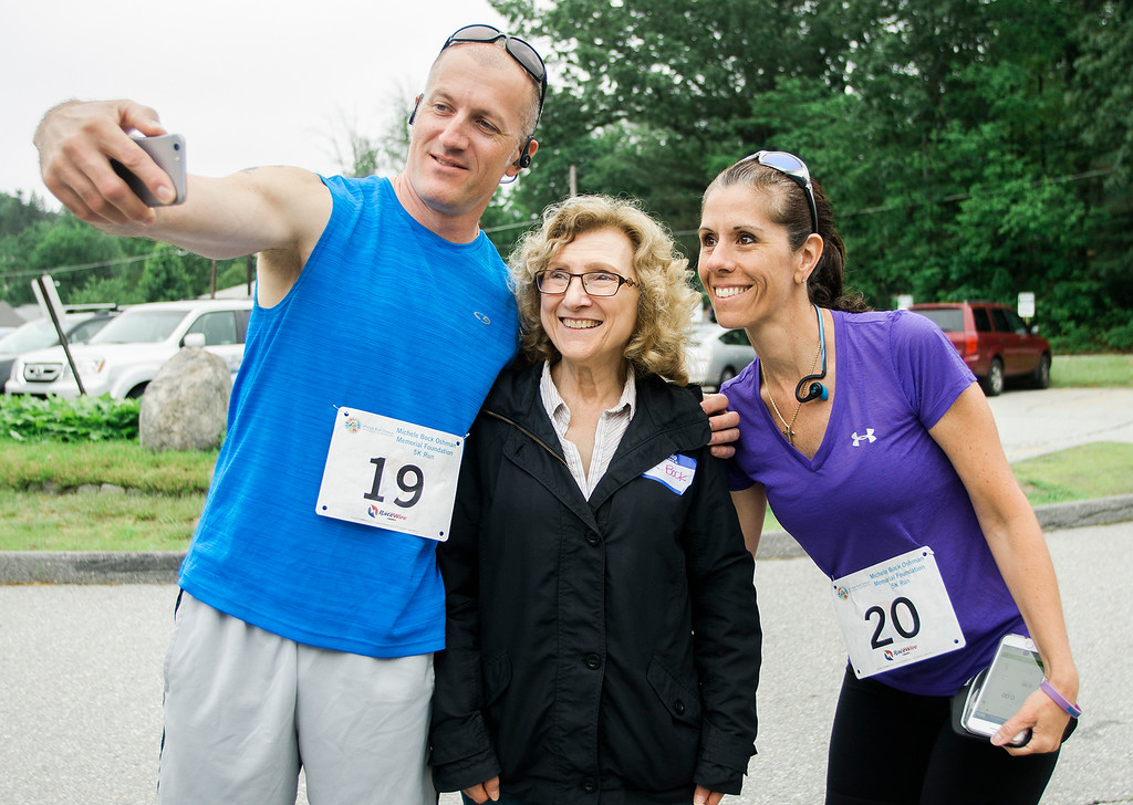 . Kevin and Lora Grimley snap a photo with Mickey Bock, te mother of Michele Oshman, ahead of the Michele Bock Oshman Memorial Foundation 5K, held at Northwest Elementary School in Leominster on Saturday, June 17, 2017. Oshman died unexpectedly in April 2016 after suffering a stroke at the age of 32. She had been working in Leominster for roughly a decade at the time of her death. SENTINEL & ENTERPRISE / Ashley Green