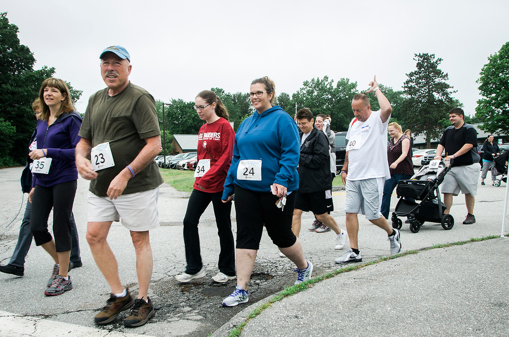 . Runners take off at the start of the Michele Bock Oshman Memorial Foundation 5K held at Northwest Elementary School in Leominster on Saturday, June 17, 2017. Oshman died unexpectedly in April 2016 after suffering a stroke at the age of 32. She had been working in Leominster for roughly a decade at the time of her death. SENTINEL & ENTERPRISE / Ashley Green