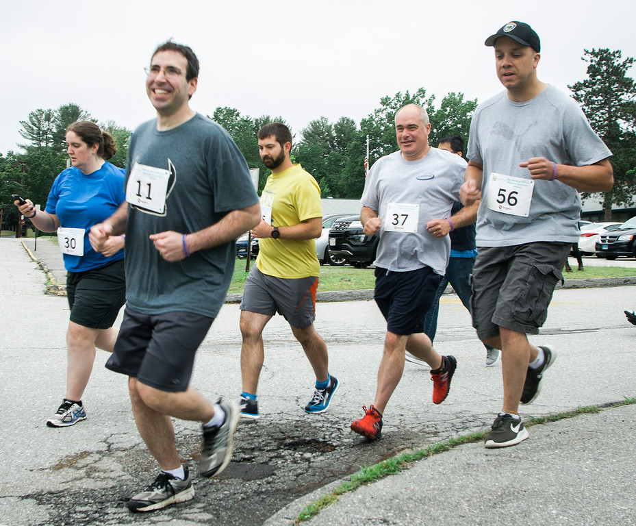 . #11 James Oshman, the husband of Michele Oshman, takes off at the start of the Michele Bock Oshman Memorial Foundation 5K held at Northwest Elementary School in Leominster on Saturday, June 17, 2017. Oshman died unexpectedly in April 2016 after suffering a stroke at the age of 32. She had been working in Leominster for roughly a decade at the time of her death. SENTINEL & ENTERPRISE / Ashley Green