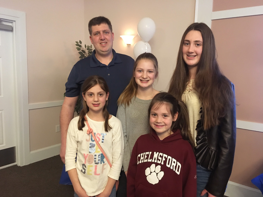 . Michael Boucher of Chelmsford with daughters, from left, Ava, Ruby, Stella, and Sophie