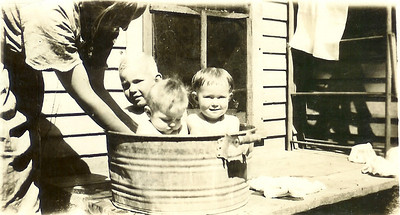 November 16 rub a dub dub...that is my grandpa in the tub! (oldest blonde baby in the back!)