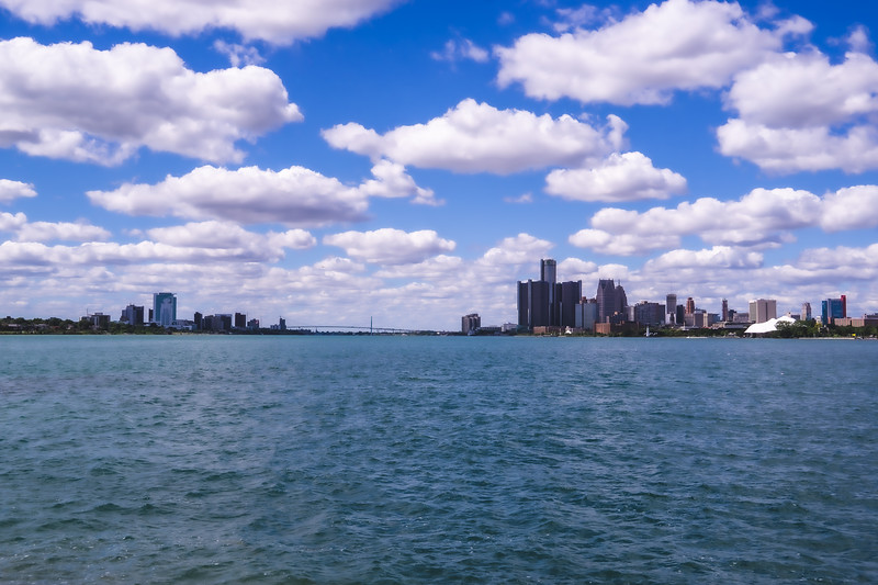 The Dual Skylines of Detroit Michigan and Windsor Ontario with the Ambassador Bridge connecting taken from Belle Isle State Park