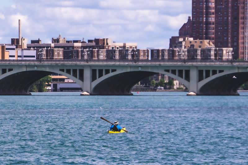 A Kayaker heading towards the MacArthur Bridge on the Detroit River