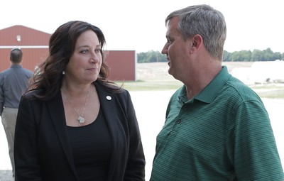Eaton County farmer Duane Smuts speaks with Rep. Angela Whitwer about this years farming conditions.