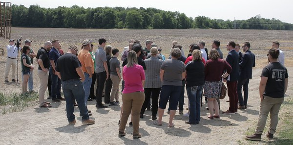 A gathering of farmers, ag industry leaders, government officials and media on the Eaton County farm of Duane Smuts.