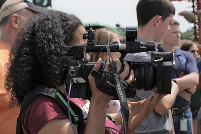 WLNS TV 6 videographer capturing images of the Governor's visit to Smuts Farms.