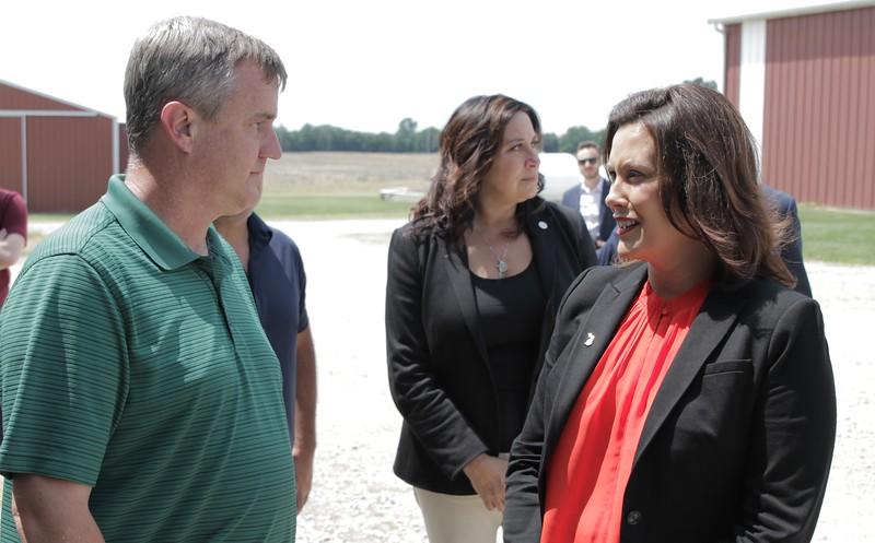 Eaton County Farm Bureau member Duane Smuts greets Gov. Gretchen Whitmer to his farm.