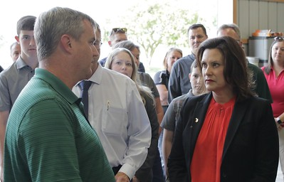 Gov. Whitmer listens to the concerns about this year's farming conditions from Duane Smuts.