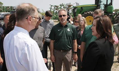 Gov. Gretchen Whitmer, Eaton County farmer Duane Smuts, MFB Director Jeff Sandborn listen to MDARD Director Gary McDowell (right to left).