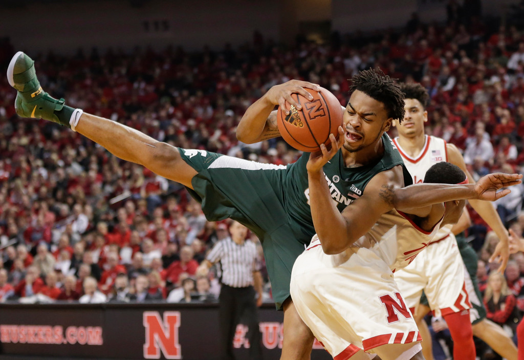 . Michigan State\'s Nick Ward, left, lands on top of Nebraska\'s Glynn Watson Jr. (5) during the first half of an NCAA college basketball game in Lincoln, Neb., Thursday, Feb. 2, 2017. (AP Photo/Nati Harnik)