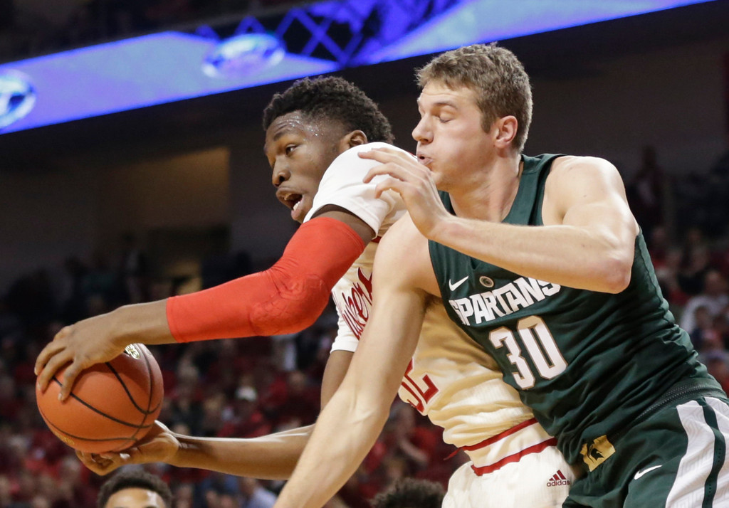 . Nebraska\'s Jordy Tshimanga (32) grabs a rebound in front of Michigan State\'s Matt Van Dyk (30) during the first half of an NCAA college basketball game in Lincoln, Neb., Thursday, Feb. 2, 2017. (AP Photo/Nati Harnik)