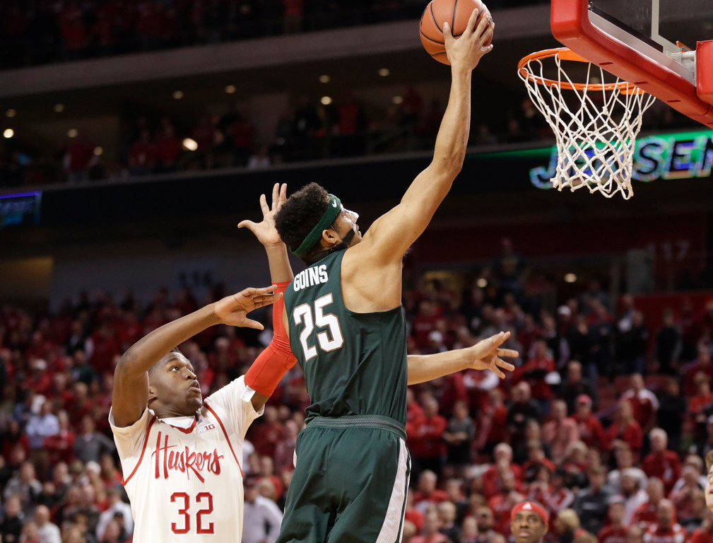 . Michigan State\'s Kenny Goins (25) scores over Nebraska\'s Jordy Tshimanga (32) during the first half of an NCAA college basketball game in Lincoln, Neb., Thursday, Feb. 2, 2017. (AP Photo/Nati Harnik)