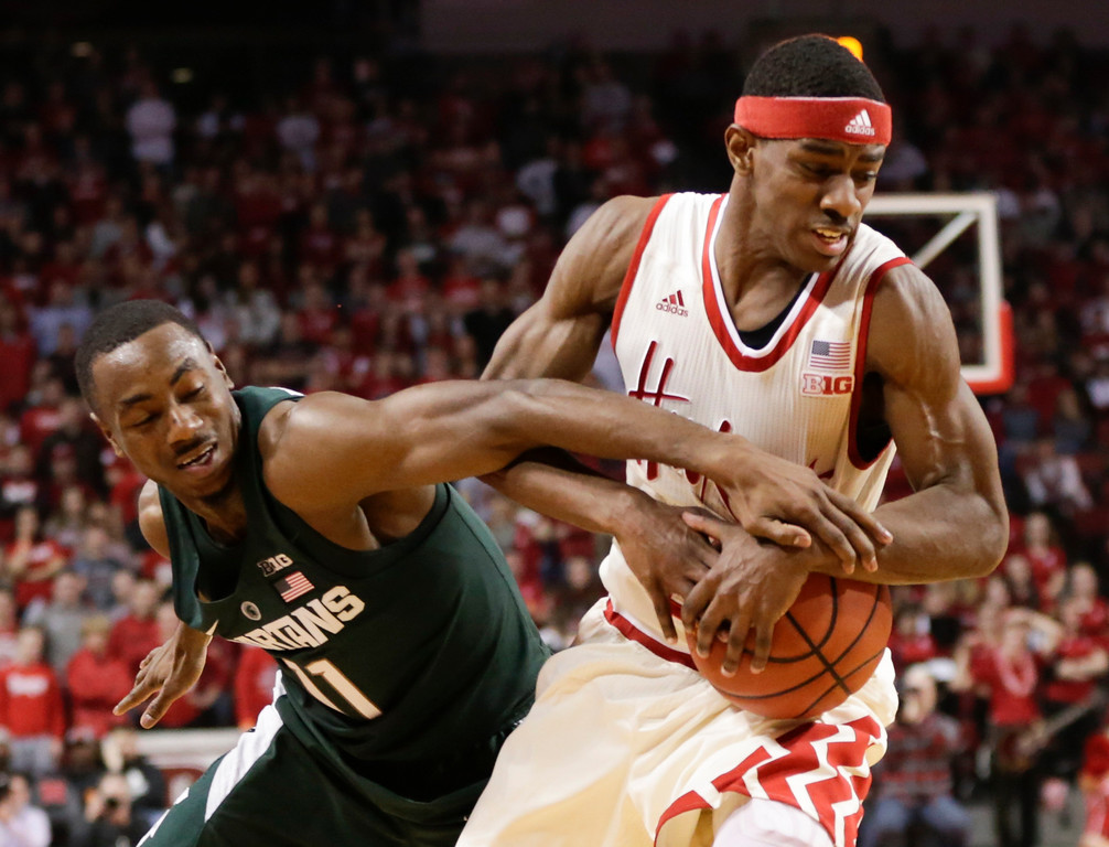 . Michigan State\'s Lourawls Nairn Jr. (11) tries to extract the ball away from Nebraska\'s Glynn Watson Jr., right, during the first half of an NCAA college basketball game in Lincoln, Neb., Thursday, Feb. 2, 2017. (AP Photo/Nati Harnik)