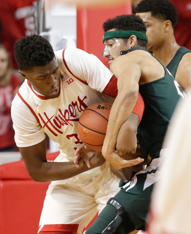 . Michigan State\'s Kenny Goins, right, fouls Nebraska\'s Jordy Tshimanga (32) as they struggle for the ball during the first half of an NCAA college basketball game in Lincoln, Neb., Thursday, Feb. 2, 2017. (AP Photo/Nati Harnik)