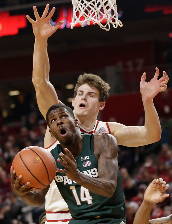 . Michigan State\'s Eron Harris (14) goes for a layup in front of Nebraska\'s Michael Jacobson, rear, during the first half of an NCAA college basketball game in Lincoln, Neb., Thursday, Feb. 2, 2017. (AP Photo/Nati Harnik)