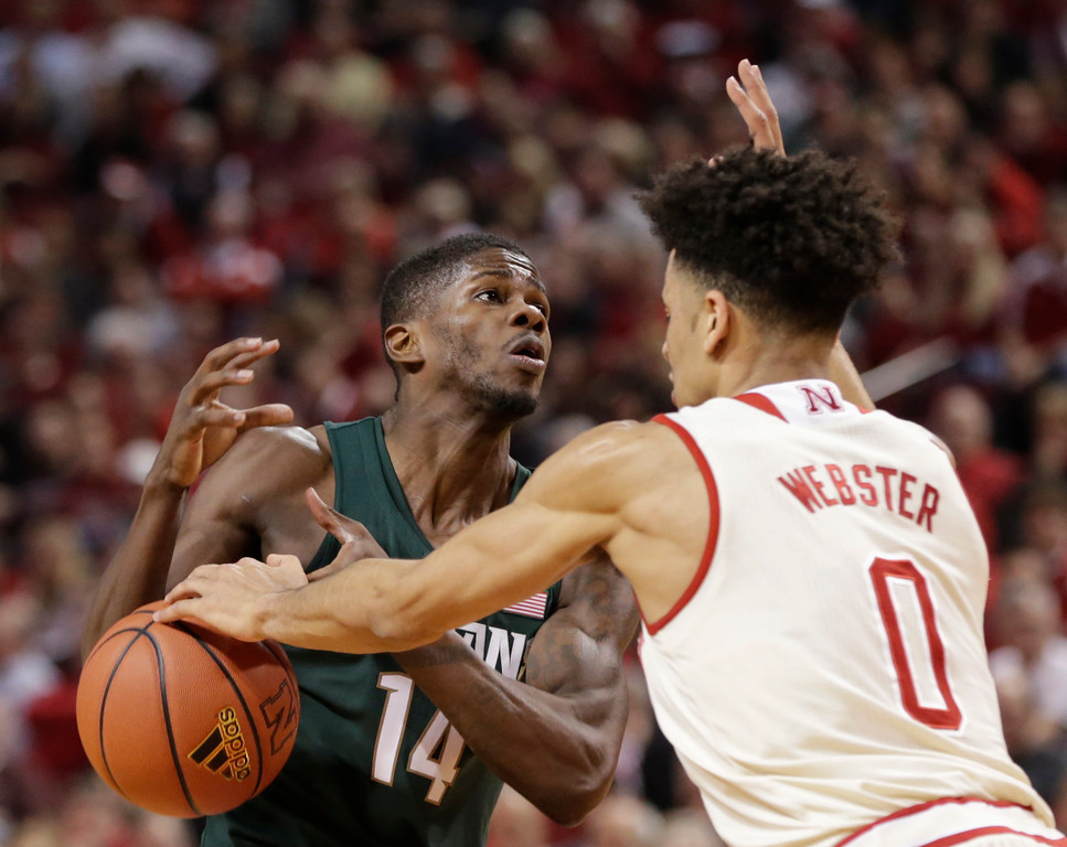 . Nebraska\'s Tai Webster (0) knocks the ball away from Michigan State\'s Eron Harris (14) during the first half of an NCAA college basketball game in Lincoln, Neb., Thursday, Feb. 2, 2017. (AP Photo/Nati Harnik)