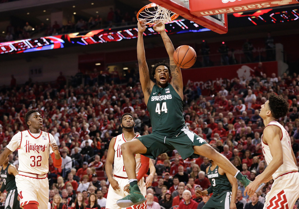 . Michigan State\'s Nick Ward (44) dunks over Nebraska\'s Jordy Tshimanga (32), Jeriah Horne, rear center, and Tai Webster, right, during the first half of an NCAA college basketball game in Lincoln, Neb., Thursday, Feb. 2, 2017. (AP Photo/Nati Harnik)