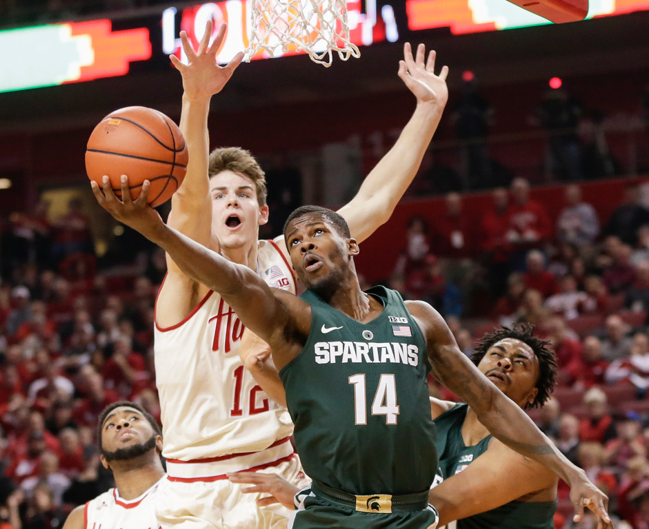 . Michigan State\'s Eron Harris (14) goes for a layup in front of Nebraska\'s Michael Jacobson (12), with Nebraska\'s Jeriah Horne, left, and Michigan State\'s Nick Ward, right, watching during the first half of an NCAA college basketball game in Lincoln, Neb., Thursday, Feb. 2, 2017. (AP Photo/Nati Harnik)