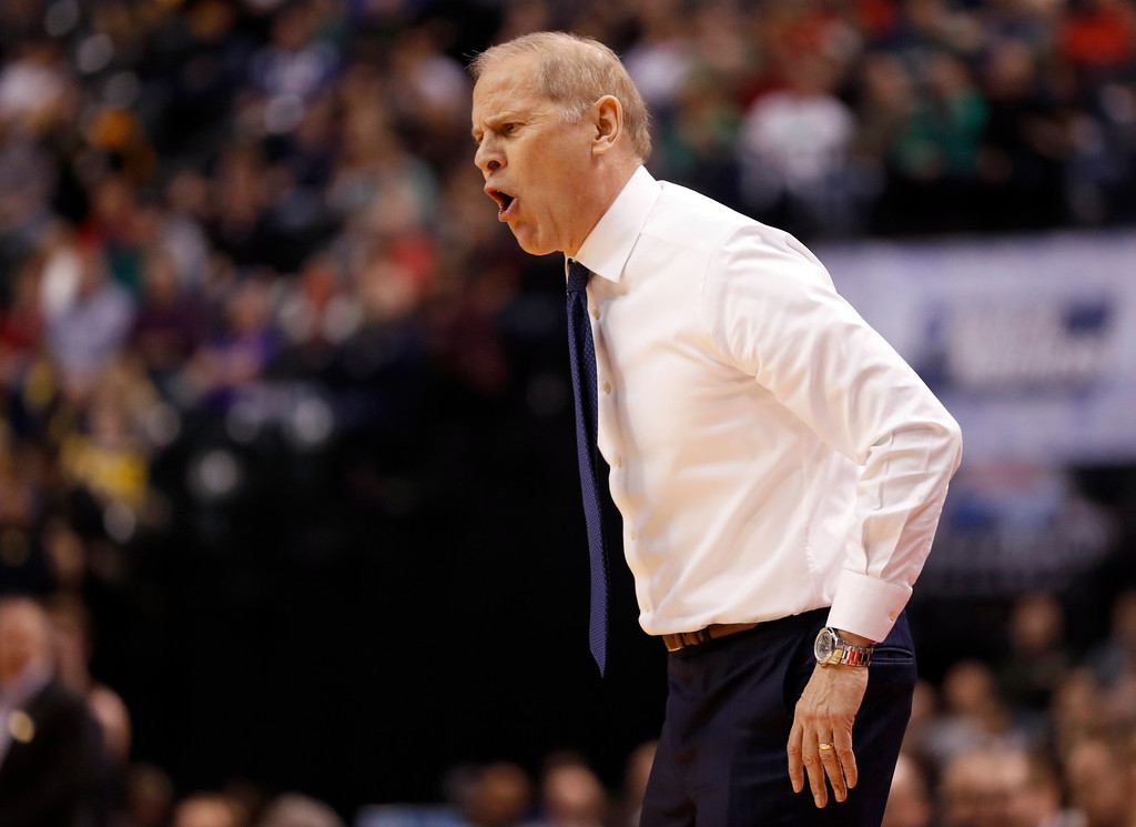 . Michigan head coach John Beilein is seen on the sidelines during the first half of a first-round game against Oklahoma State in the men\'s NCAA college basketball tournament Friday, March 17, 2017, in Indianapolis, Mo. (AP Photo/Jeff Roberson)