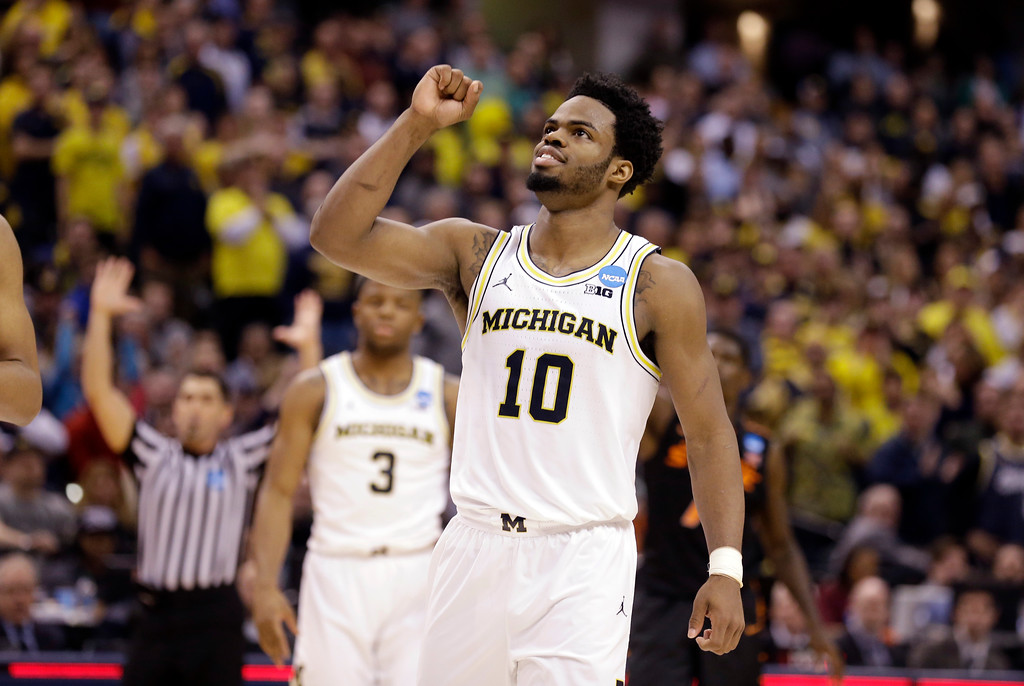 . Michigan guard Derrick Walton Jr. (10) celebrates after Michigan defeated Oklahoma State 92-91 in a first-round game in the men\'s NCAA college basketball tournament in Indianapolis, Friday, March 17, 2017. (AP Photo/Michael Conroy)
