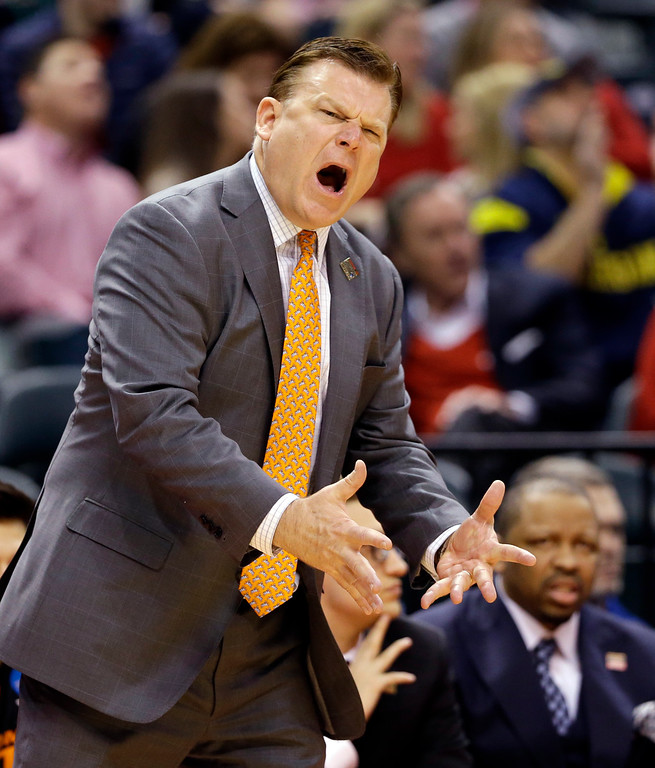. Oklahoma State head coach Brad Underwood yells from the sideline during a first-round game against Michigan in the men\'s NCAA college basketball tournament in Indianapolis, Friday, March 17, 2017. (AP Photo/Michael Conroy)