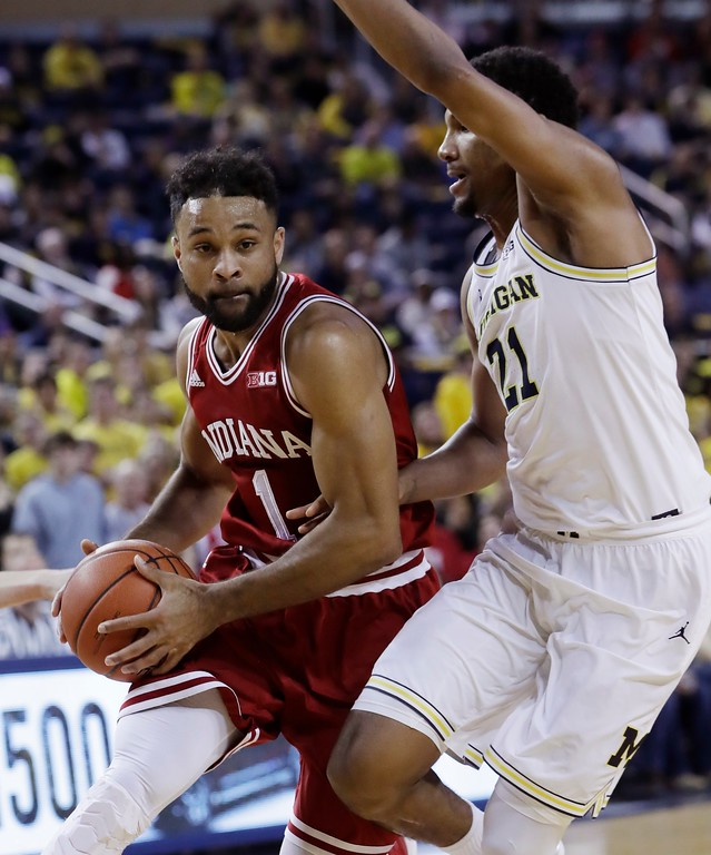 . Indiana guard James Blackmon Jr. (1) drives around Michigan guard Zak Irvin during the first half of an NCAA college basketball game, Thursday, Jan. 26, 2017, in Ann Arbor, Mich. (AP Photo/Carlos Osorio)