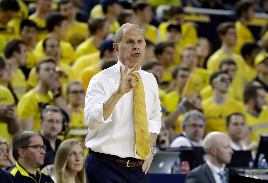 . Michigan head coach John Beilein gestures from the sidelines during the first half of an NCAA college basketball game against Indiana, Thursday, Jan. 26, 2017, in Ann Arbor, Mich. (AP Photo/Carlos Osorio)