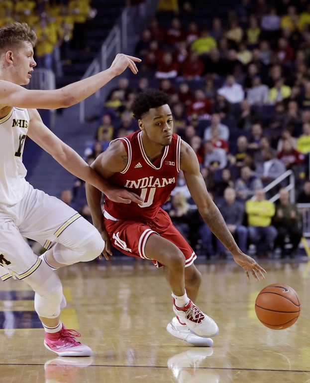 . Indiana guard Curtis Jones (0) drives around Michigan forward Moritz Wagner during the first half of an NCAA college basketball game, Thursday, Jan. 26, 2017, in Ann Arbor, Mich. (AP Photo/Carlos Osorio)