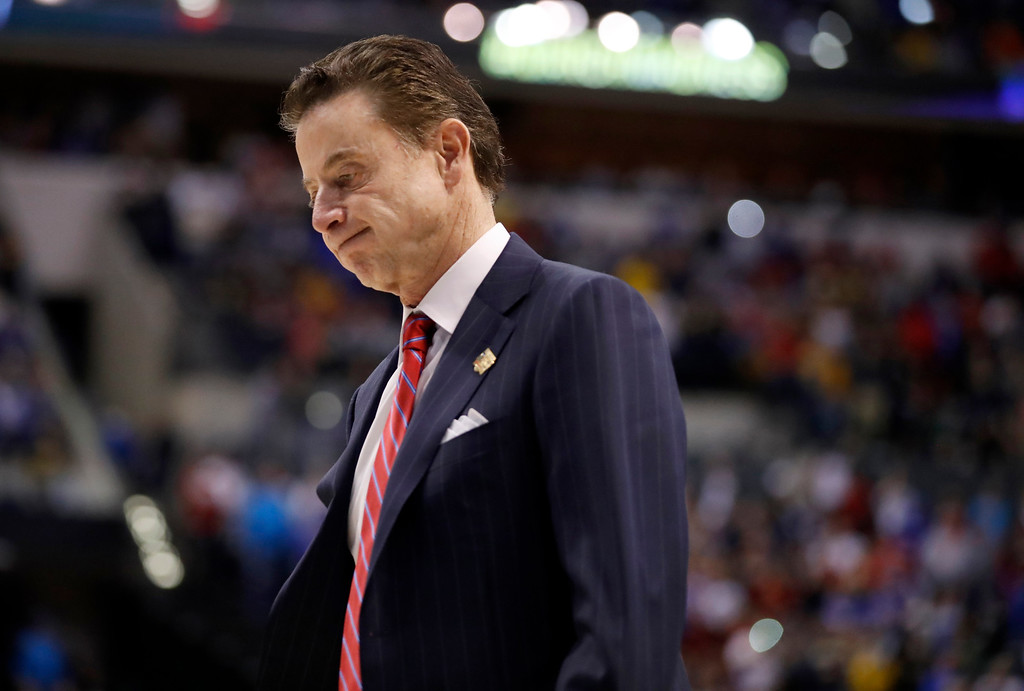 . Louisville head coach Rick Pitino walks off the court after a 73-69 loss to Michigan in a second-round game in the men\'s NCAA college basketball tournament Sunday, March 19, 2017, in Indianapolis. (AP Photo/Jeff Roberson)