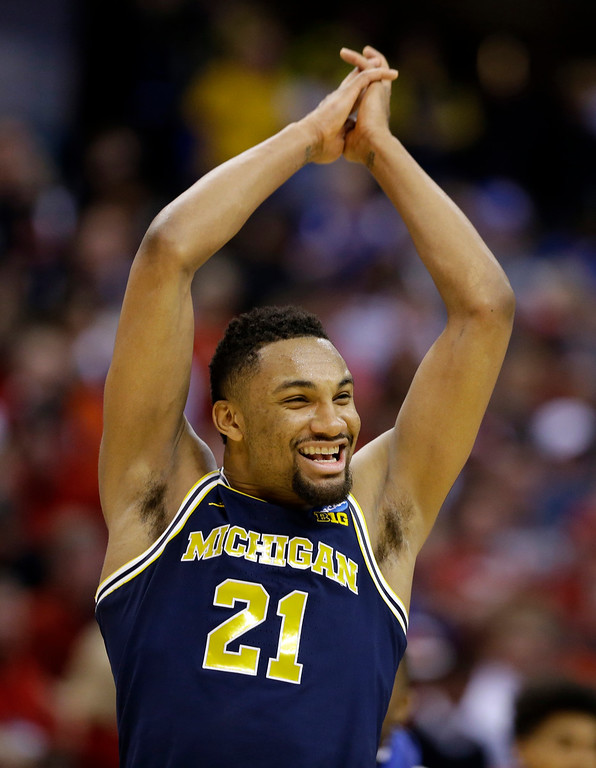 . Michigan guard Zak Irvin (21) celebrates a 73-69 win over Louisville in a second-round game in the men�s NCAA college basketball tournament in Indianapolis, Sunday, March 19, 2017. (AP Photo/Michael Conroy)