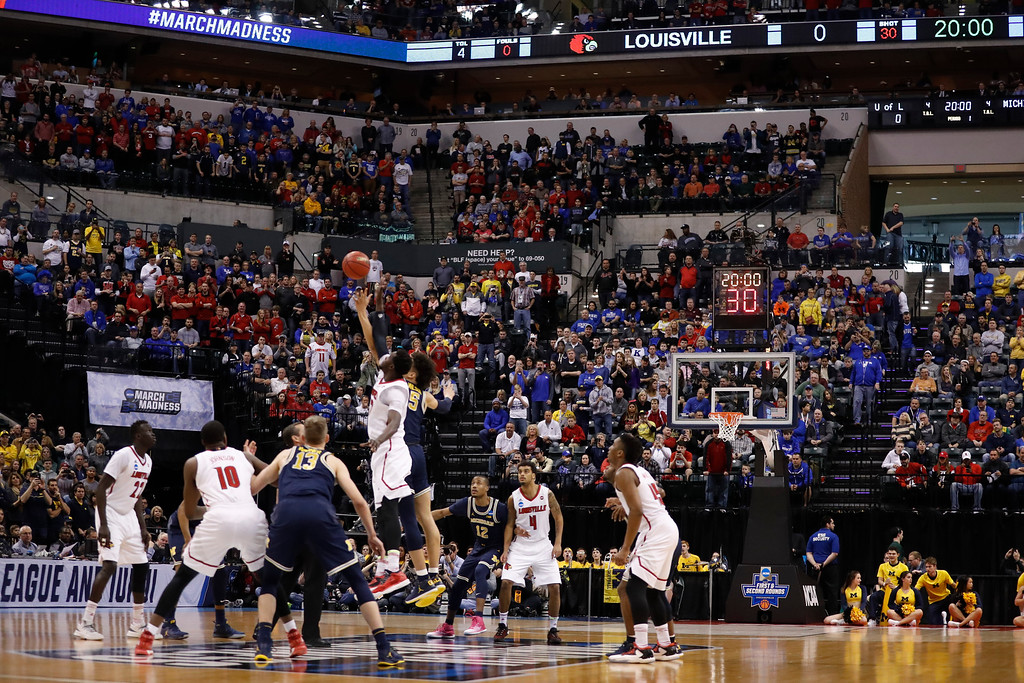 . Louisville and Michigan tip off during the first half of a second-round game in the men\'s NCAA college basketball tournament Sunday, March 19, 2017, in Indianapolis. (AP Photo/Jeff Roberson)