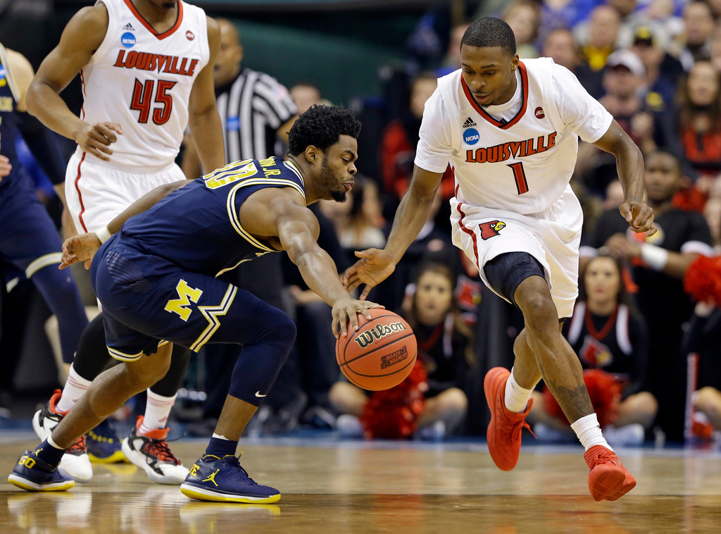 . Michigan guard Derrick Walton Jr. (10) grabs a loose ball in front of Louisville guard Tony Hicks (1) during the first half of a second-round game in the men�s NCAA college basketball tournament in Indianapolis, Sunday, March 19, 2017. (AP Photo/Michael Conroy)