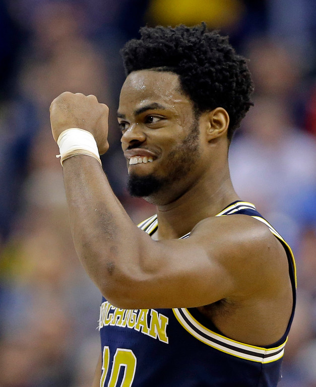 . Michigan guard Derrick Walton Jr. (10) celebrates a 73-69 win over Louisville in a second-round game in the men�s NCAA college basketball tournament in Indianapolis, Sunday, March 19, 2017. (AP Photo/Michael Conroy)