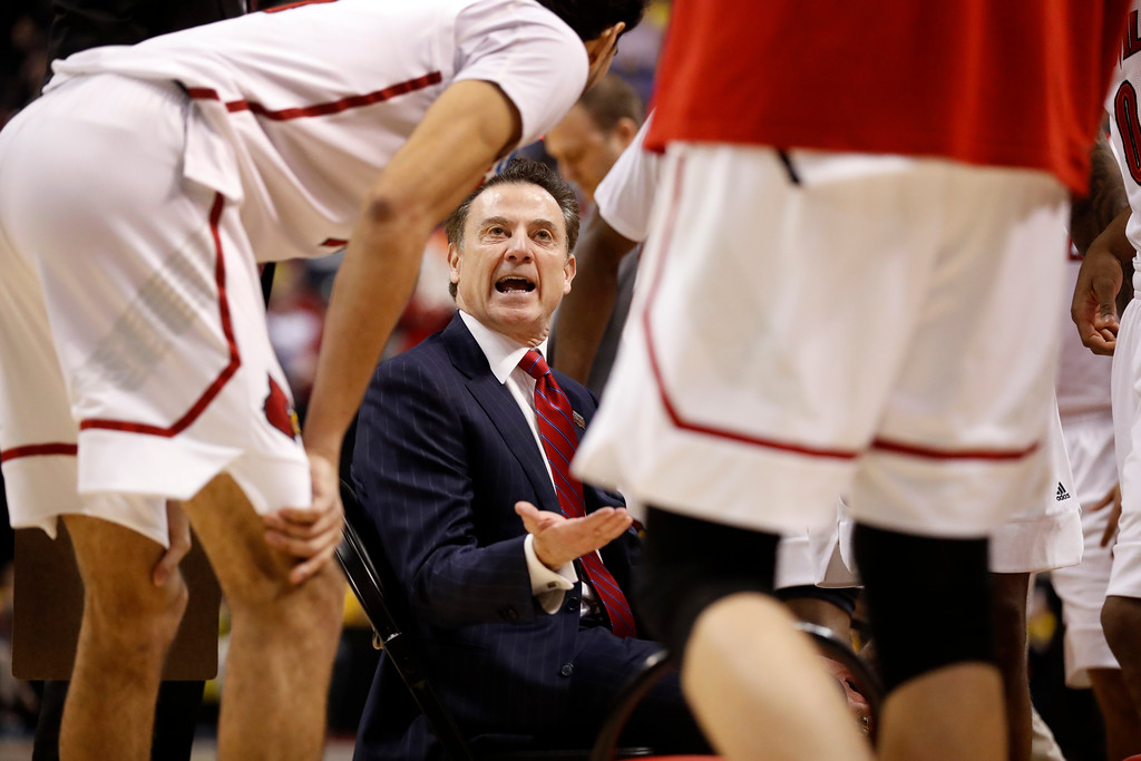 . Louisville head coach Rick Pitino talks to his team during timeout in the first half of a second-round game against Michigan in the men\'s NCAA college basketball tournament Sunday, March 19, 2017, in Indianapolis. (AP Photo/Jeff Roberson)