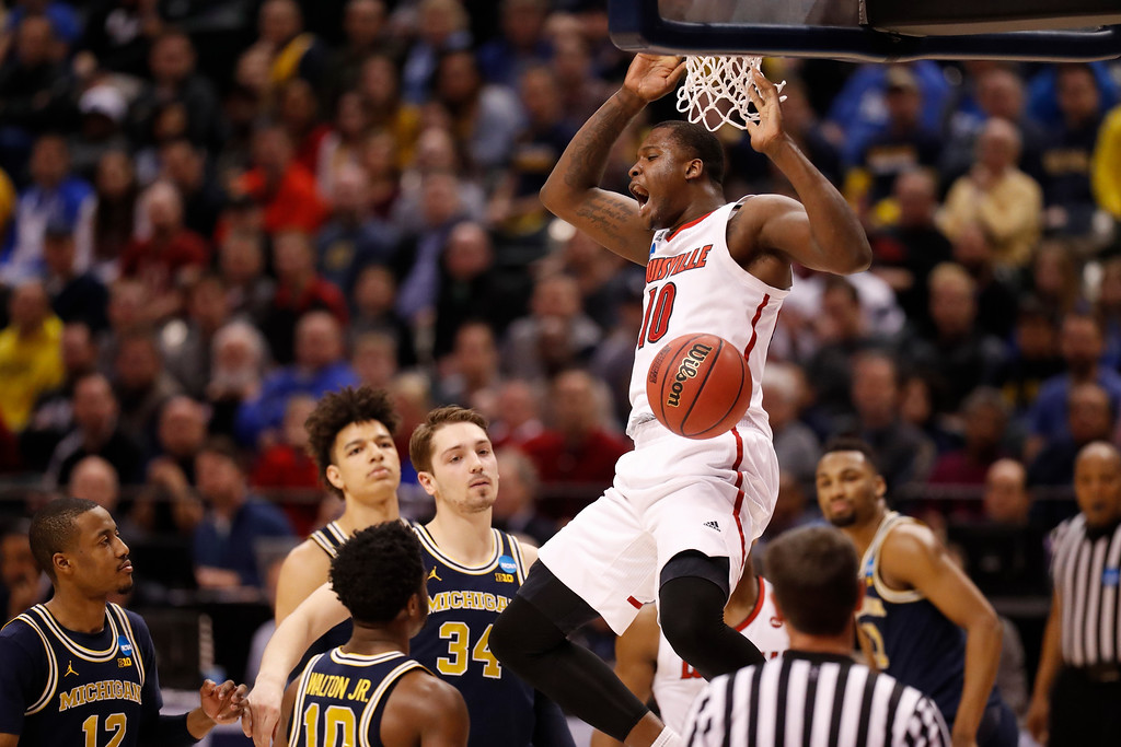 . Louisville\'s Jaylen Johnson dunks the ball during the first half of a second-round game against Michigan in the men\'s NCAA college basketball tournament Sunday, March 19, 2017, in Indianapolis. (AP Photo/Jeff Roberson)
