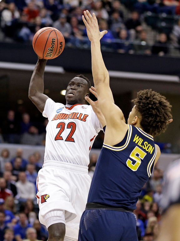 . Louisville forward Deng Adel (22) goes up for a dunk over Michigan forward D.J. Wilson (5) during the first half of a second-round game in the men�s NCAA college basketball tournament in Indianapolis, Sunday, March 19, 2017. (AP Photo/Michael Conroy)