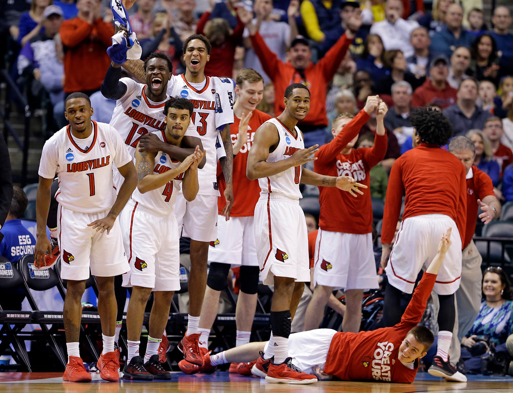 . The Louisville bench celebrates during the first half of a second-round game against Michigan  in the men�s NCAA college basketball tournament in Indianapolis, Sunday, March 19, 2017. (AP Photo/Michael Conroy)