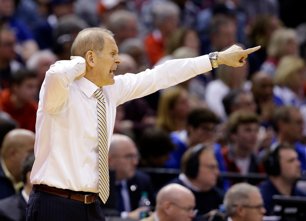 . Michigan head coach John Beilein gestures from the bench as his team played Louisville during the second half of a second-round game in the men�s NCAA college basketball tournament in Indianapolis, Sunday, March 19, 2017. Michigan defeated Louisville 73-69. (AP Photo/Michael Conroy)