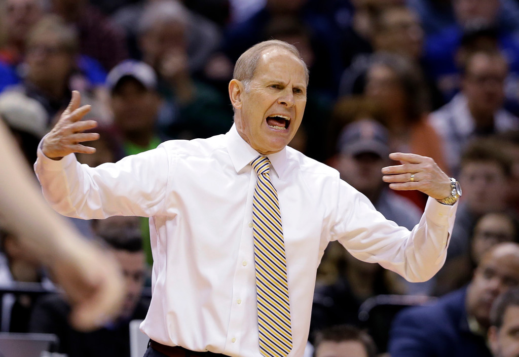 . Michigan head coach John Beilein questions a call during the first half of a second-round game against Louisville  in the men�s NCAA college basketball tournament in Indianapolis, Sunday, March 19, 2017. (AP Photo/Michael Conroy)